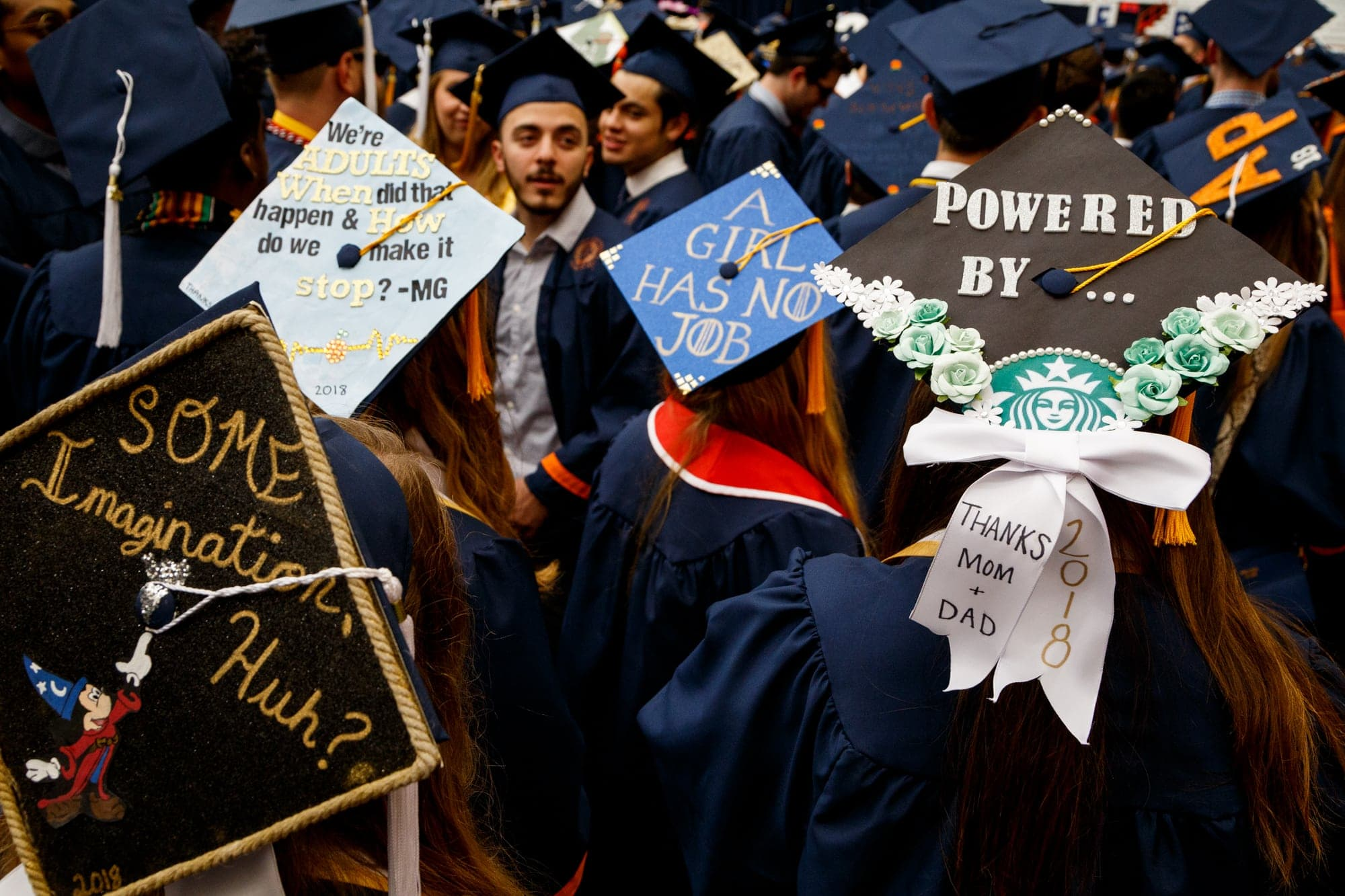 Decorated caps at graduation ceremony