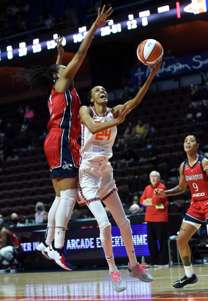 Connecticut Sun forward/guard DeWanna Bonner (24) goes up for a shot as her sister, Washington Mystics forward Erica McCall (left), contests in a game on May 28, 2021. (Photo credit: Khoi Ton)