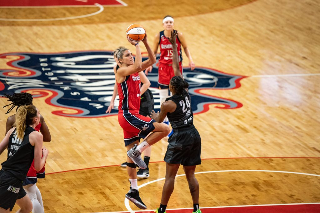 Washington Mystics forward/guard Elena Delle Donne shoots over Seattle Storm guard Jewell Loyd in a game on Aug. 22, 2021. (Photo credit: Domenic Allegra)