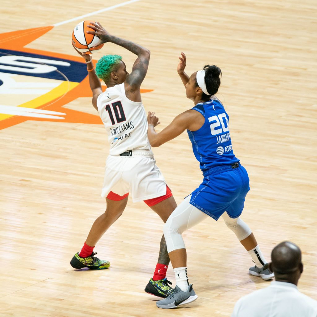 Atlanta Dream guard Courtney Williams (10) defended by Connecticut Sun guard Briann January (20) during the WNBA game between the Atlanta Dream and the Connecticut Sun at Mohegan Sun Arena, Uncasville, Connecticut, USA on July 09, 2021. Photo Credit: Chris Poss