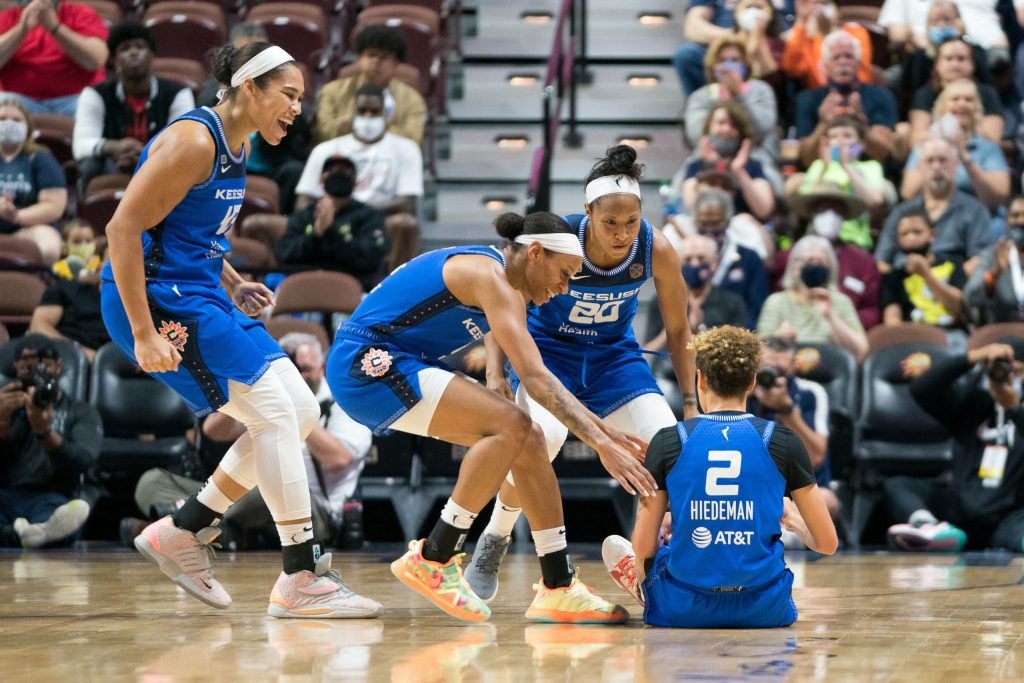 Connecticut Sun forward Brionna Jones (42) Connecticut Sun guard Briann January (20) and Connecticut Sun guard Jasmine Thomas (5) react after Connecticut Sun guard Natisha Hiedeman (2) is fouled during a made three point shot during the WNBA game between the Atlanta Dream and the Connecticut Sun at Mohegan Sun Arena, Uncasville, Connecticut, USA on September 19, 2021. Photo Credit: Chris Poss