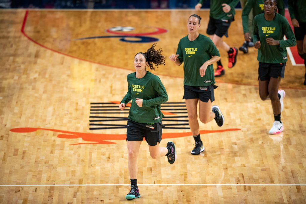 Point guard Sue Bird leads the Seattle Storm onto the court for pregame warmups before a game against the Washington Mystics on Aug. 22, 2021. (Photo credit: Domenic Allegra)