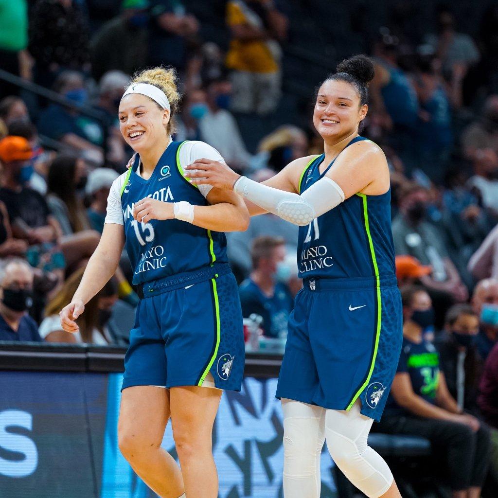 Rachel Banham and Kayla McBride celebrate the Minnesota Lynx 74-66 victory over the New York Liberty