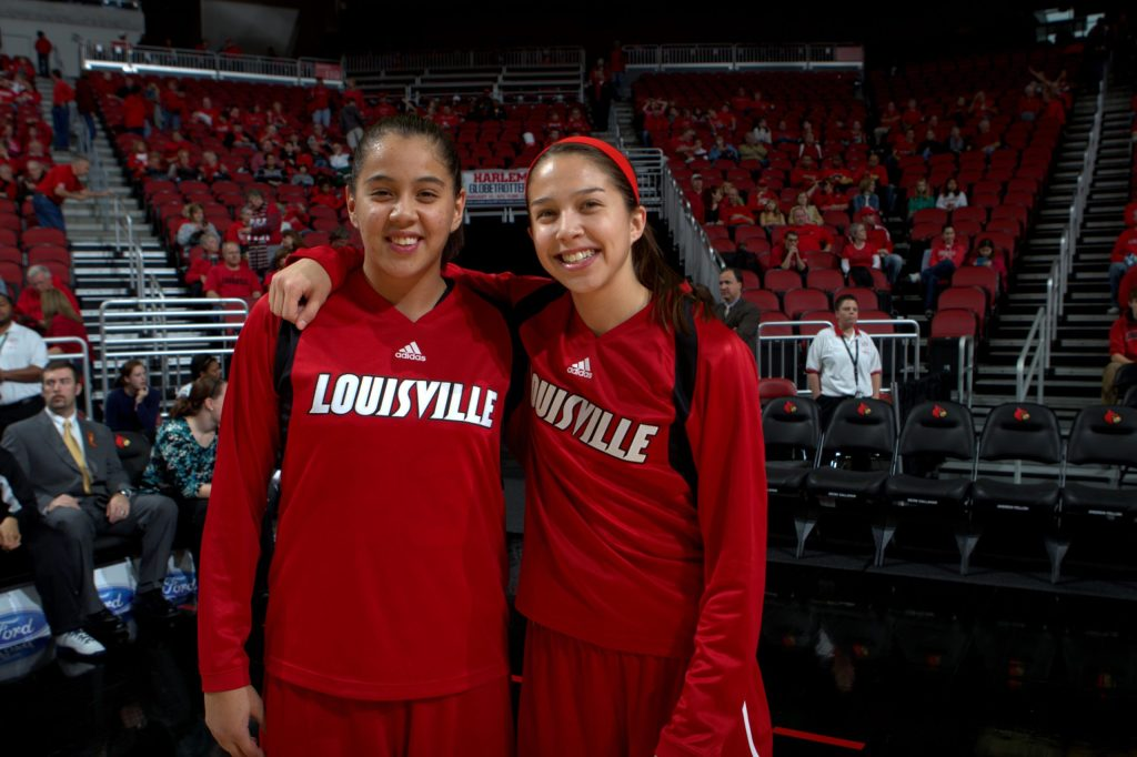 Shoni (left) and Jude Schimmel pose for a photo during the 2011-12 college basketball season. (Photo credit: UofL Athletics)