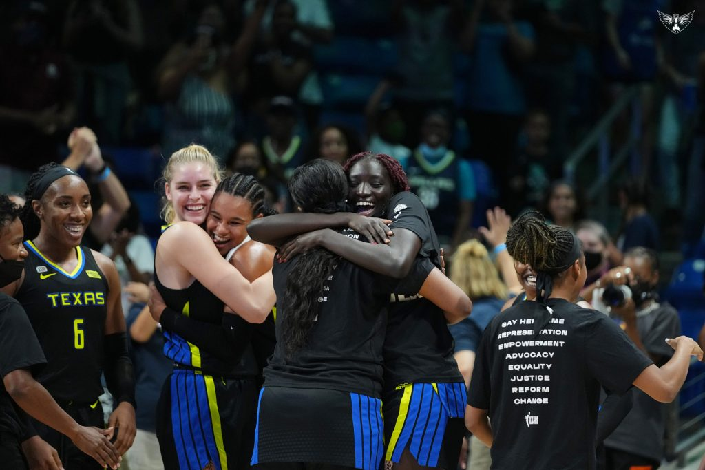 The Dallas Wings celebrating at the end of the game against the New York Liberty. The Wings secured the seventh seed. Photo Credit: Dallas Wings Twitter Account.
