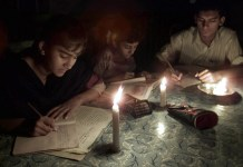 Pakistani students study by candlelight after a blackout as they prepare for their annual examinations in Karachi late March 28, 2001. Pakistan is facing a deepening electricity crisis due to falling water levels at key hydro power stations after prolonged drought.
