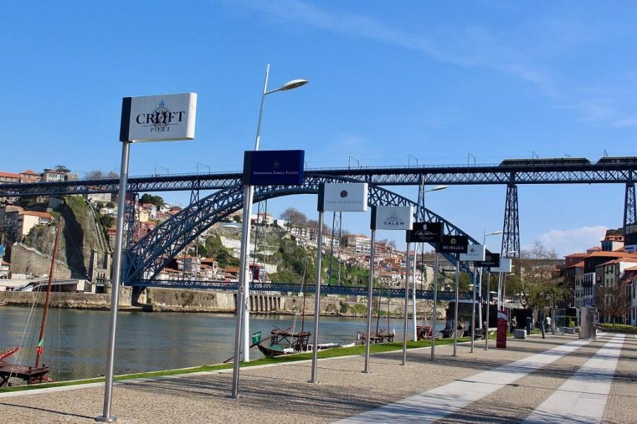wine cellars line douro river in porto