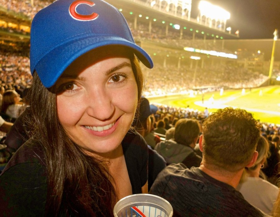 woman in cubs hat at wrigley field