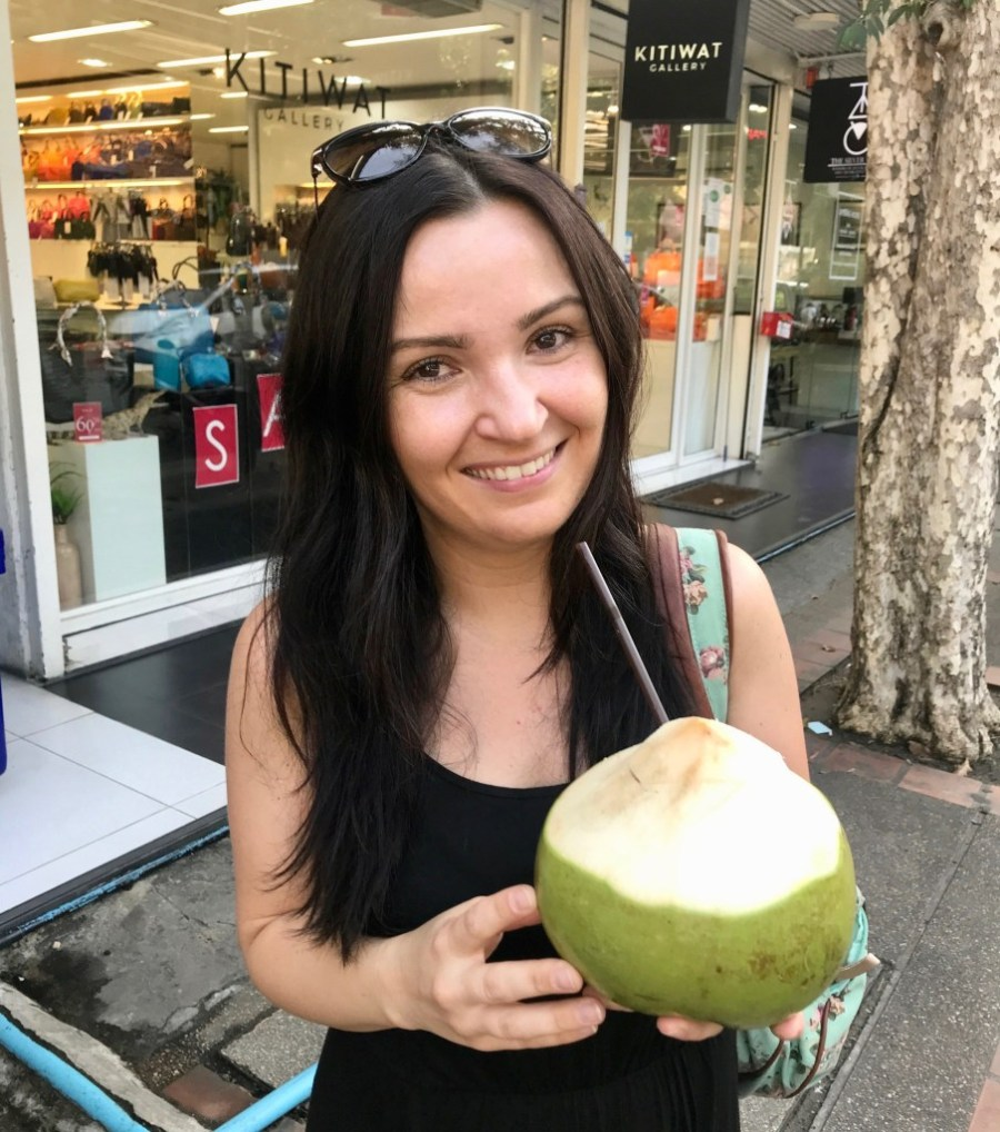 woman with fresh coconut water