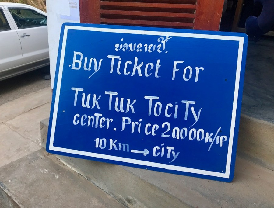 sign for tuk tuk price in luang prabang