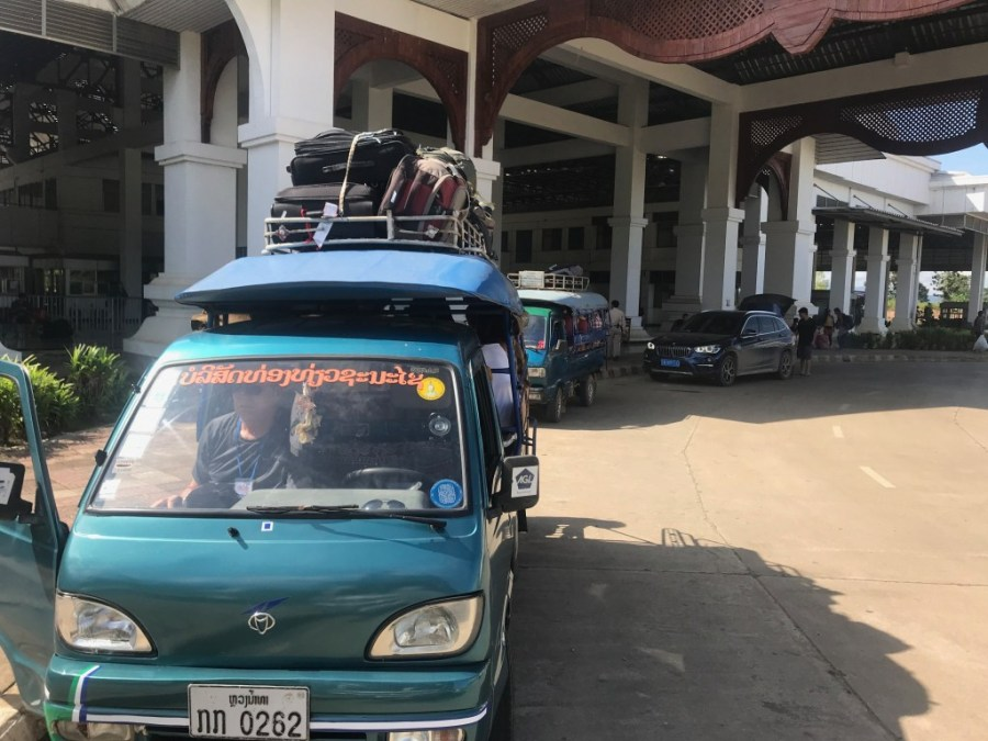 tuk tuk parked outside border control building