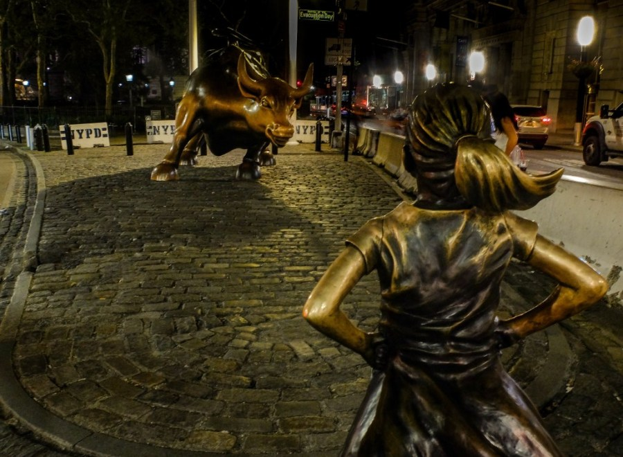fearless girl and wall street bull in financial district