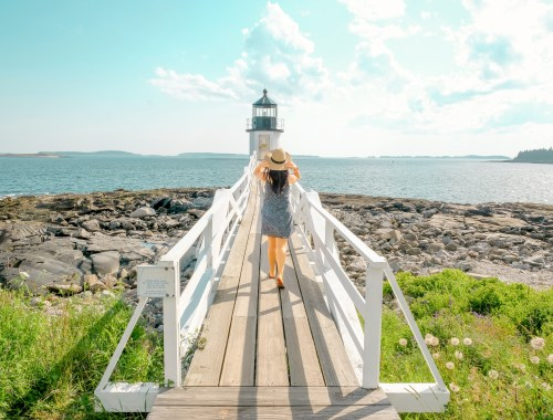 woman on bridge of lighthouse