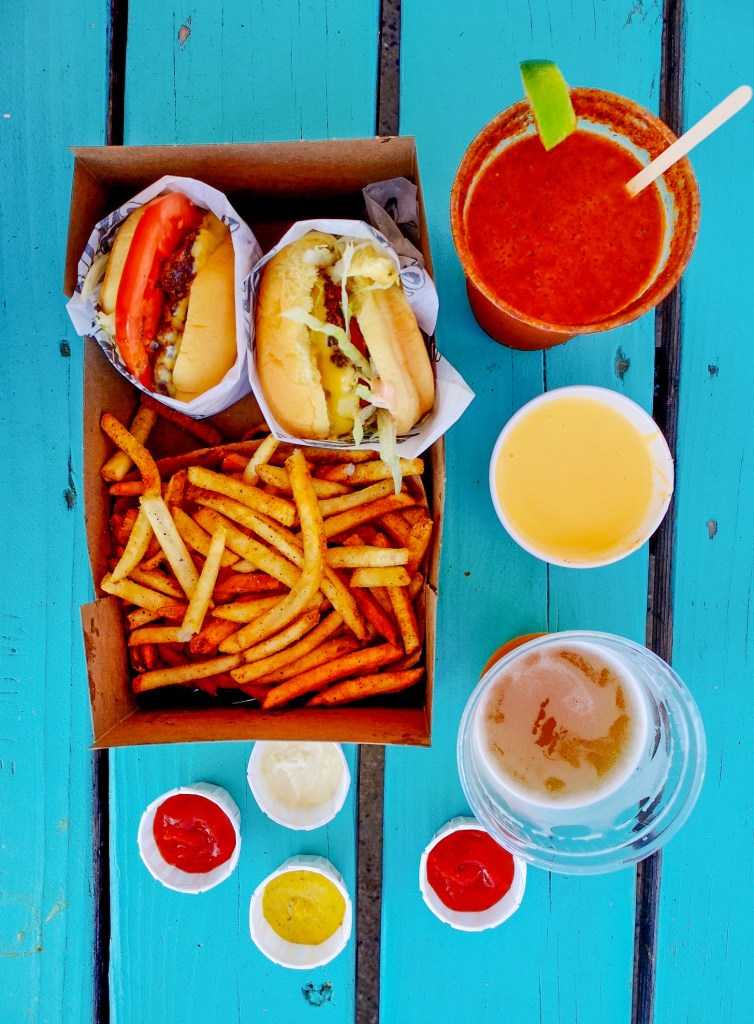 top down photo of burgers, fries, and drinks
