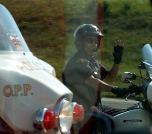 motorcycle cop waving