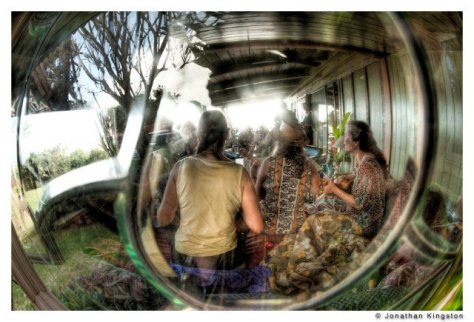 Musicians sing on the front porch of the Hui Hoolana, a retreat center on the island of Molokai, Hawaii.