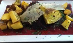 mango tofu steak with cranberry sauce, red cabbage and roasted potatoes