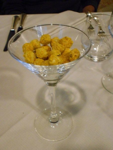 Hazelnuts seasoned with turmeric at Vecio Fritolin restaurant in Venice, Italy