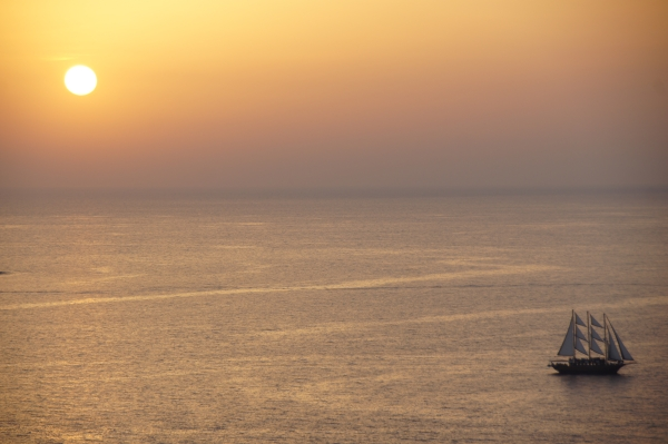 sunset with boat in Oia, Santorini