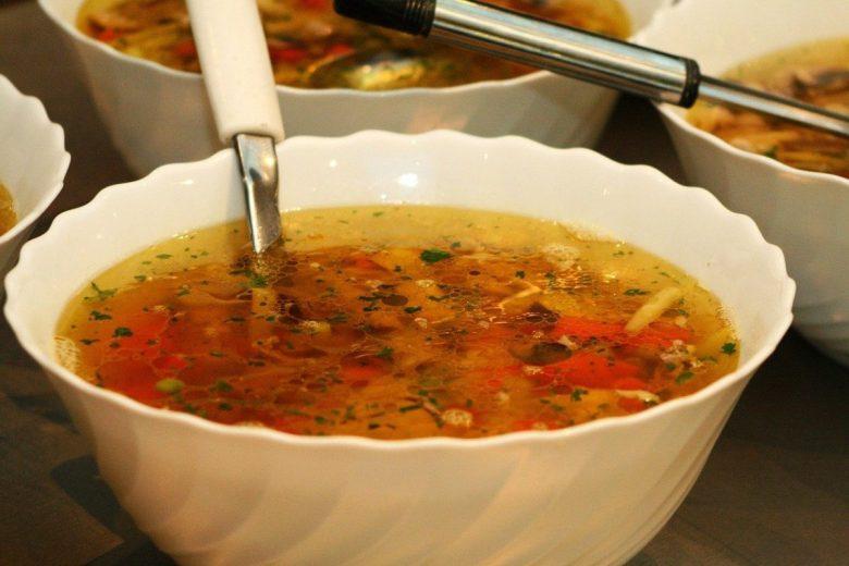 Ciorba de legume - Romanian vegetable soup served with lemon