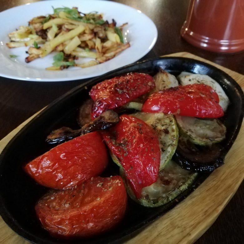 Classic vegan Russian food - potatoes, mushrooms and grilled vegetables