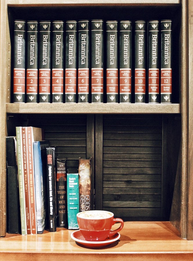 Caffeine queen, coffee, latte, coffee shop, bookshelf, shelfie