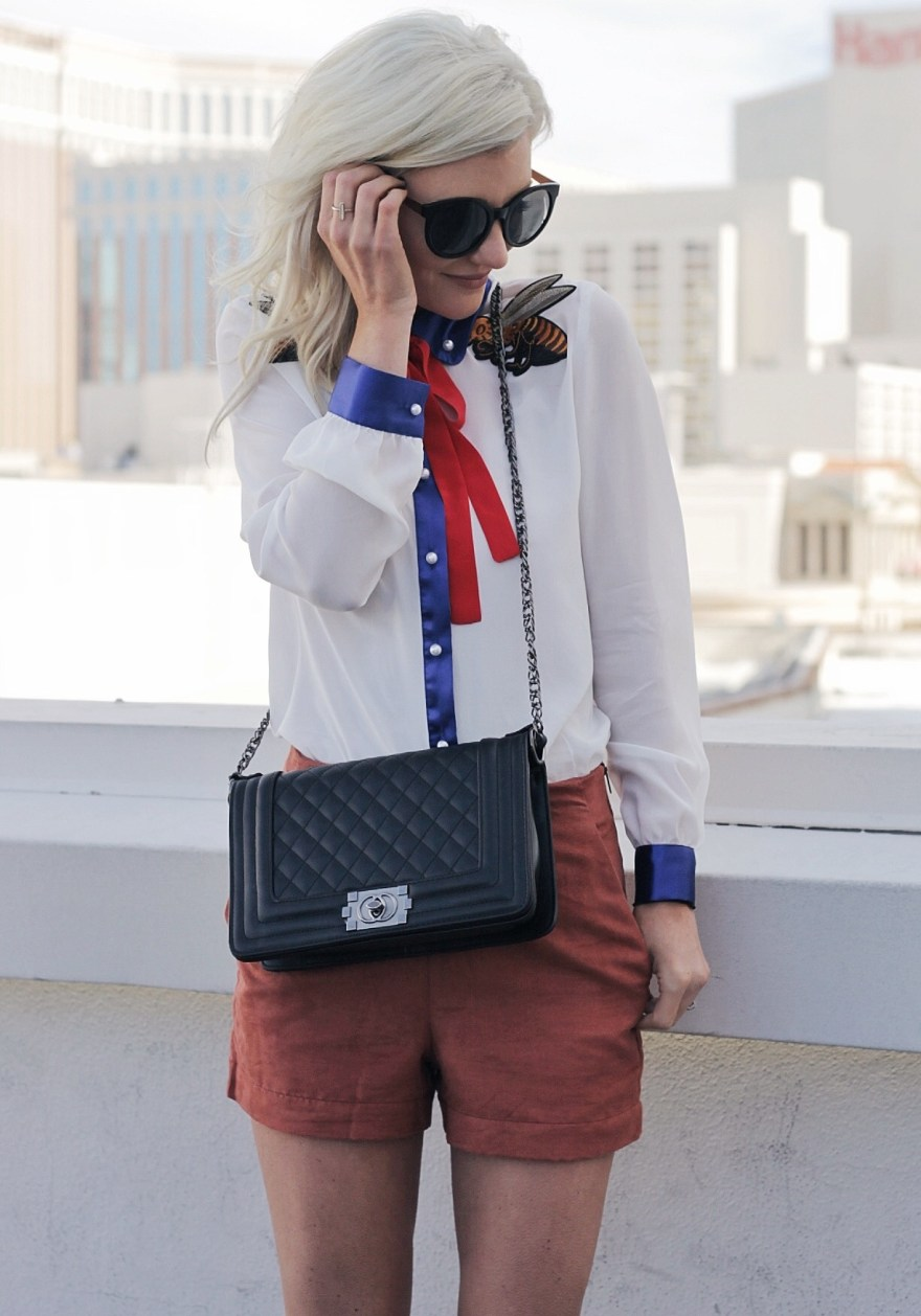 pussy bow blouse, suede shorts, vipme, revolve, cat eye sunglasses, chanel purse, spring style, outfit, fashion, style, fashion blogger, las vegas, the nomis niche, lindsey simon