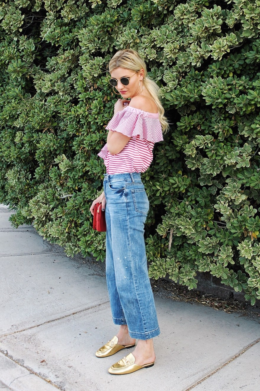 assymetric top, off the shoulder top, gold mules, cropped flares, cropped pants, red bag, striped top, summer style, weekend outfit, outfit inspo, outfit ideas, how to wear, las vegas, california, style, cali style, cali outfit, laid back style, jeans, denim, fashion, style, blogger, ootd, the nomis niche, lindsey simon
