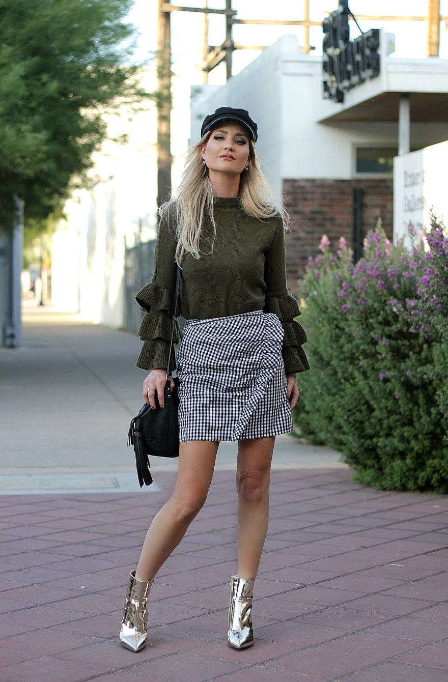 fashion, style, fall fashion, fall style, fall outfit, fall outfit ideas, street style outfit, gingham skirt, gingham, ruffle skirt, bucket bag, ruffle sleeves, statement sleeves, how to wear, gold booties, metallic booties, gold boots, baker boy hat, asos, shein, public desire, sam libby, Las Vegas fashion blogger, Las Vegas blogger, The Noms Niche, Lindsey Simon, edgy outfit, trendy, fall trends, fall 2017 trends, fall 2017 outfit,