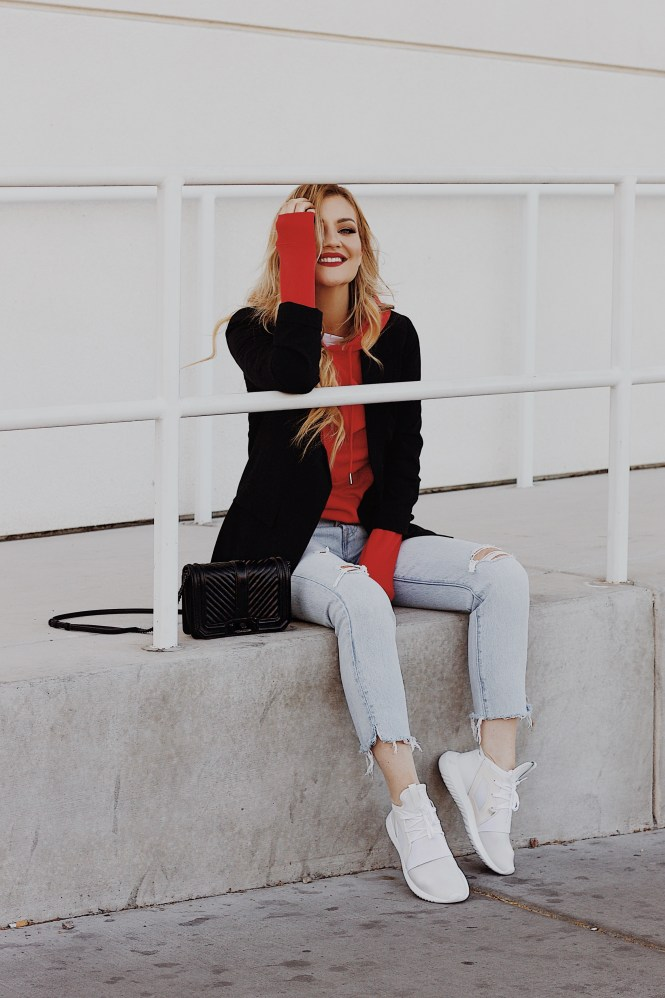 red hoodie, the nomis niche, Lindsey Simon, Lindsey Gurk, hoodie, style, how to style, how to wear, layered hoodie, casual style, ripped jeans, light wash jeans, Adidas sneakers, Las Vegas blogger, Vegas blogger, casual outfit, cool casual outfit, weekend style, blonde hair, red lips, Rebecca mink off bag, street style outfit, fall, winter 2019