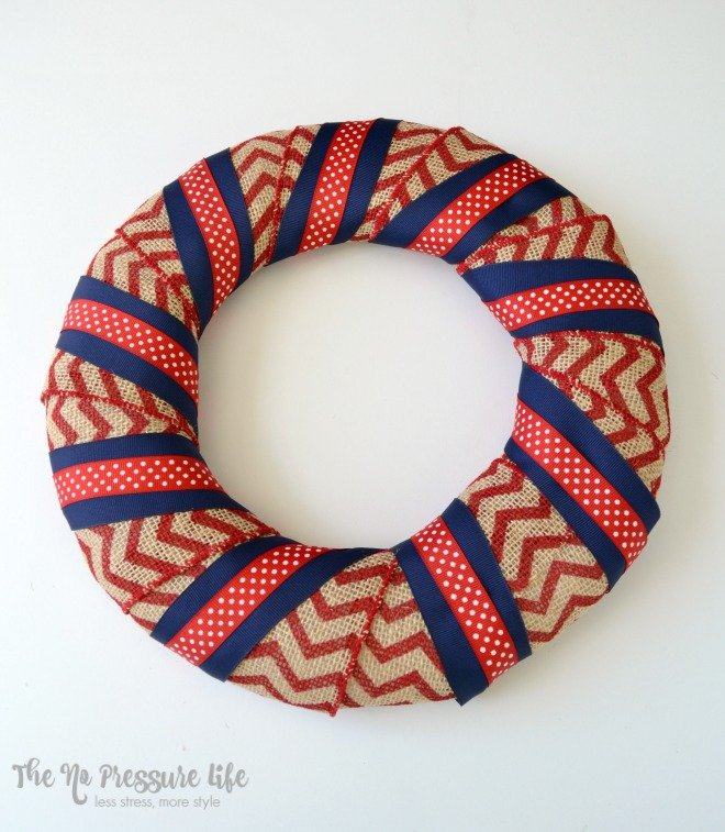 Wreath form wrapped in burlap ribbon