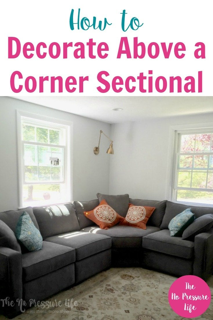 """Gray corner sectional sofa with text """"How to Decorate Above a Corner Sectional"""""""