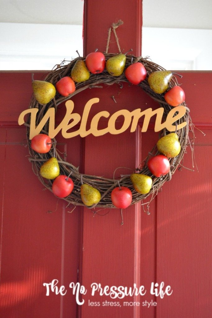 Break out the hot glue gun to make this simple DIY fall wreath with apples and pears. Simple fall wreath tutorial by The No Pressure Life.
