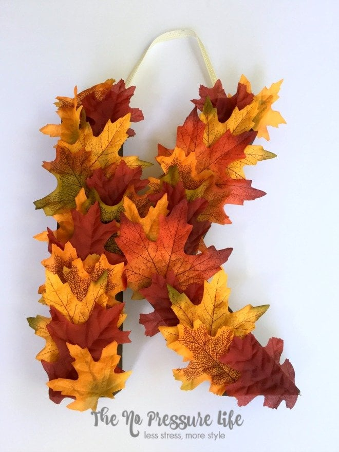 Make this pretty fall door decor in less than 20 minutes! A DIY fall monogram is an easy way to decorate your front door. Get the tutorial at The No Pressure Life.