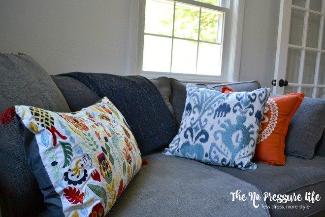 fall-pillows-on-gray-sofa