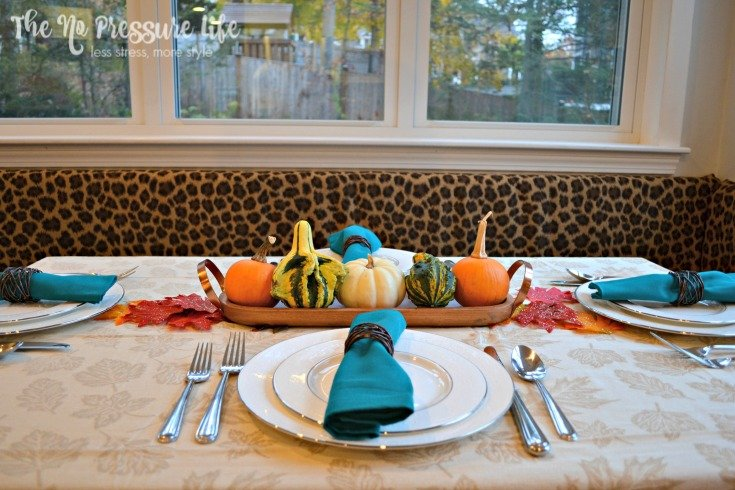 Last-minute Thanksgiving centerpiece idea: top a skinny tray with decorative gourds.