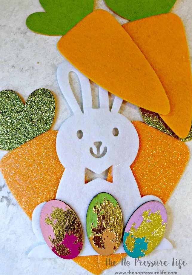 Such a cute DIY Easter wreath! Make this quick Easter decoration in 15 minutes with Target Dollar Spot supplies. Colorful Easter Bunny wreath from The No Pressure Life
