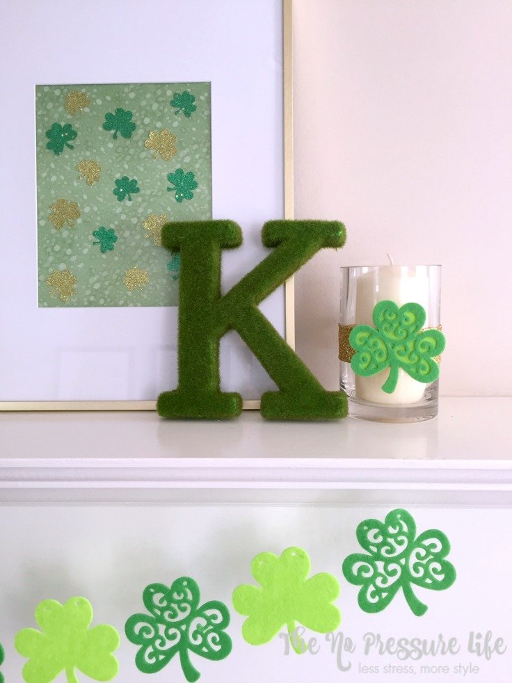 DIY St. Patrick's Day mantel decor including felt shamrock banner