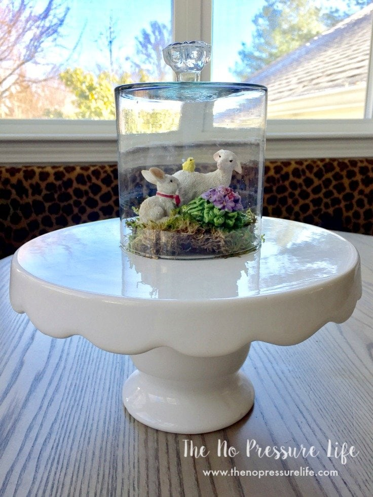 Glass DIY cloche on a white cake stand
