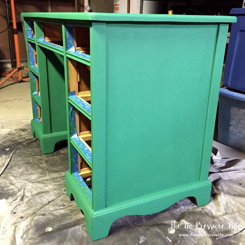 Thrift shop desk painted green on a drop cloth