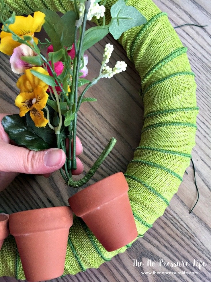How to make a summer wreath. This DIY summer wreath is great spring door decor, too. Summer wreath with flower pots and butterflies. How to make a wreath for summer.