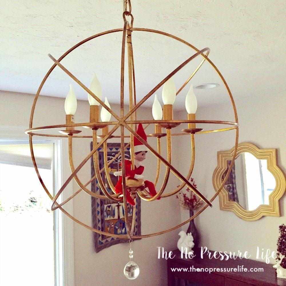 easy elf on the shelf idea: swinging from the chandelier