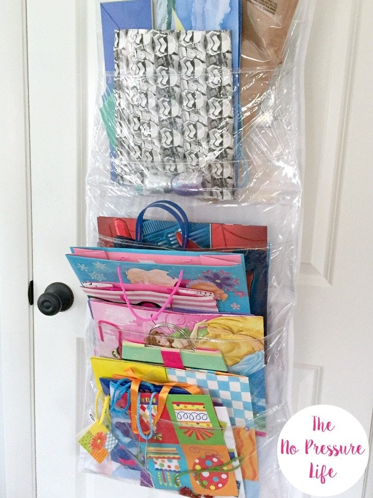 Hanging gift bag organizer and wrapping paper storage for closet