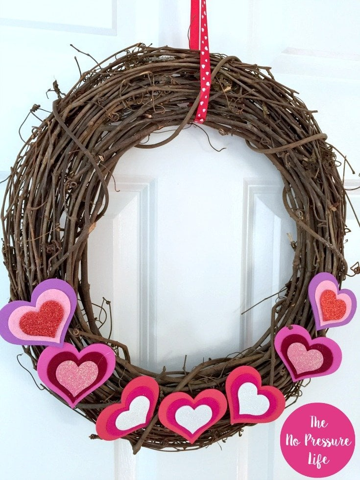 DIY Valentine's Day grapevine wreath with hearts and red ribbon