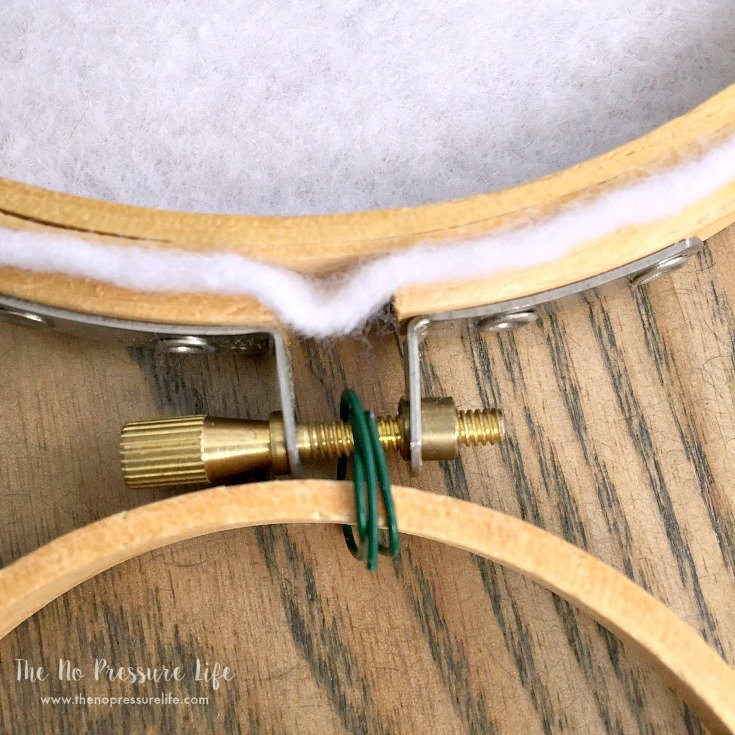 Connecting two embroidery hoops with wire to make a DIY Easter Bunny Wreath