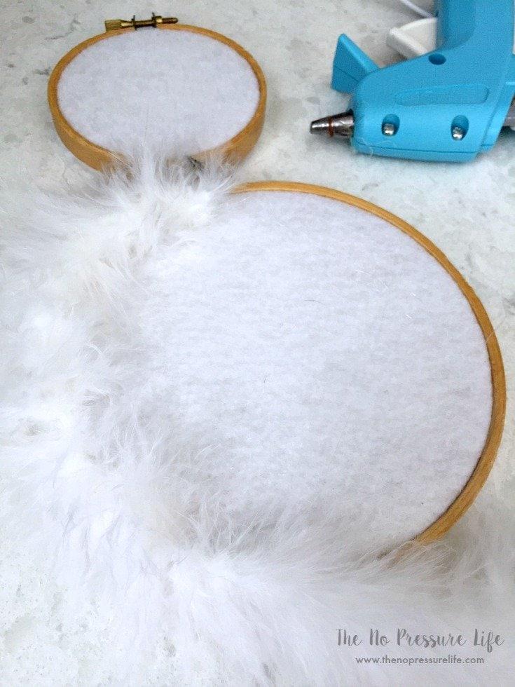 Gluing feather boa to DIY Easter Bunny Wreath