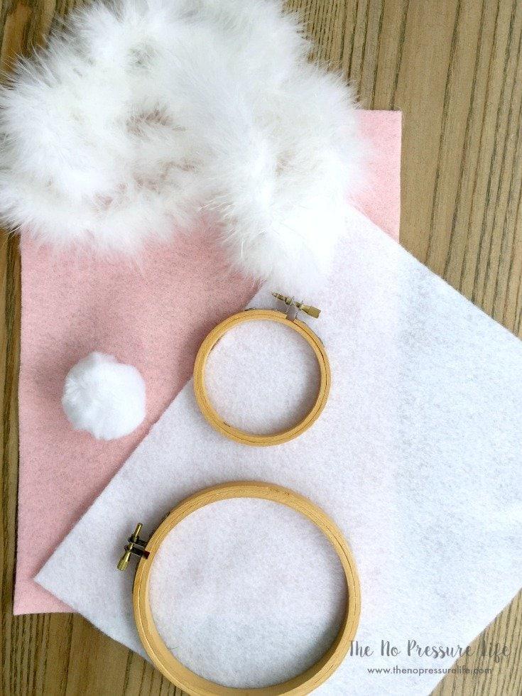 DIY Easter Bunny Wreath Supplies on a wood table