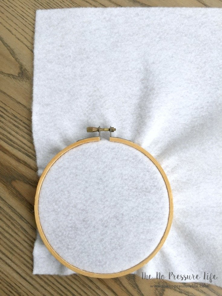 Making a DIY Easter Bunny Wreath with white felt and an embroidery hoop