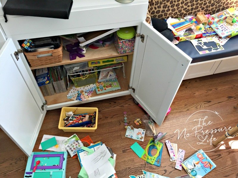 How to organize kids craft supplies in a kitchen cabinet - decluttering arts and crafts