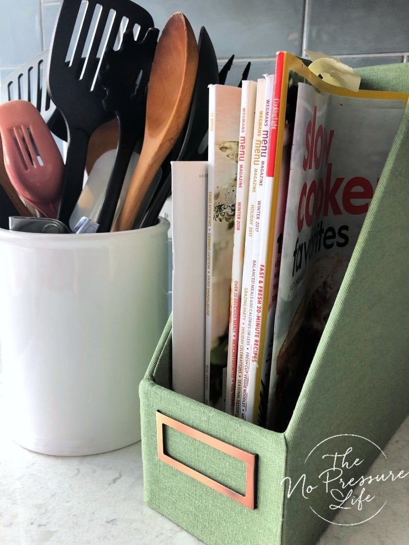 Cookbook Storage Ideas in the Kitchen - Using a magazine holder for small cookbooks and cooking magazines